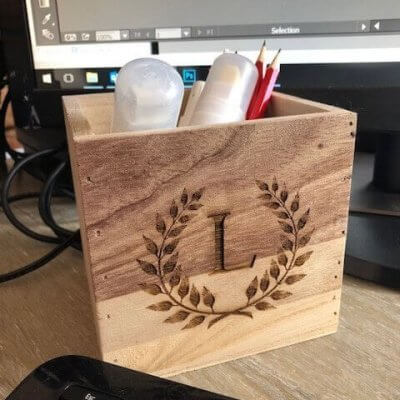 small personalised wooden box with pens